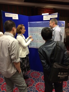 Mitrea discusses a poster during the meeting.