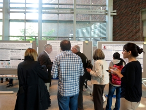 Attendees mingle during the poster session.